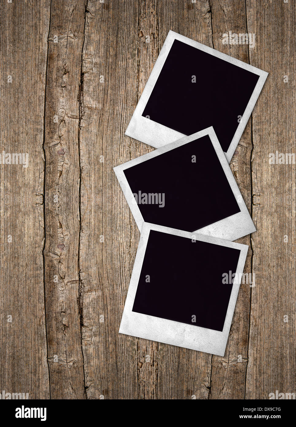three old photo frames over rustic wooden background Stock Photo ...