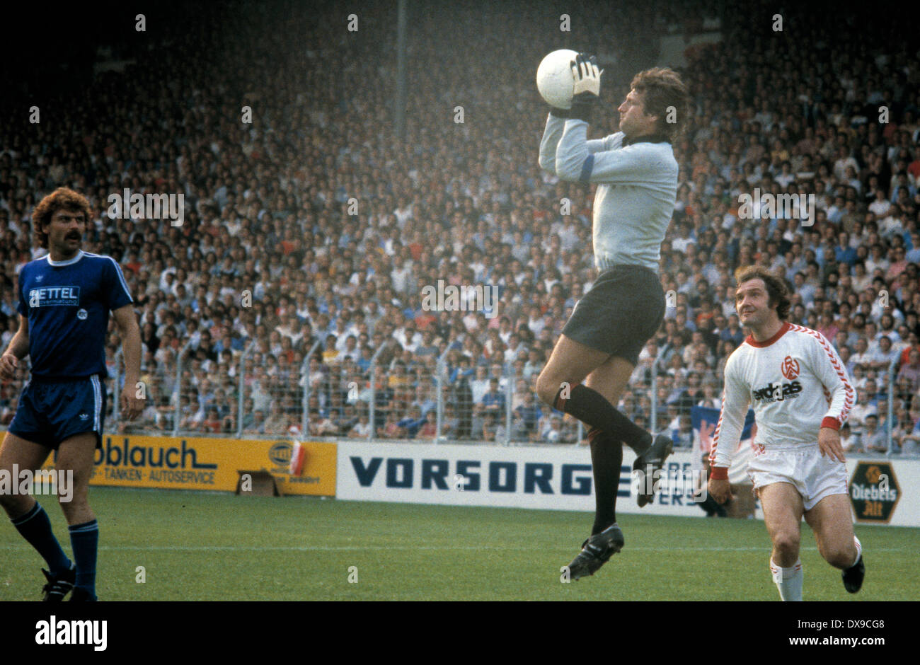 football, 2. Bundesliga Nord, 2. Bundesliga Sued, 1979/1980, relegation match to Bundesliga 1980/1981, return leg, Georg Melches Stadium, Rot Weiss Essen versus Karlsruher SC 3:1, scene of the match, f.l.t.r. Rainer Ulrich (KSC), keeper Rudolf Wimmer (KSC - Stock Image