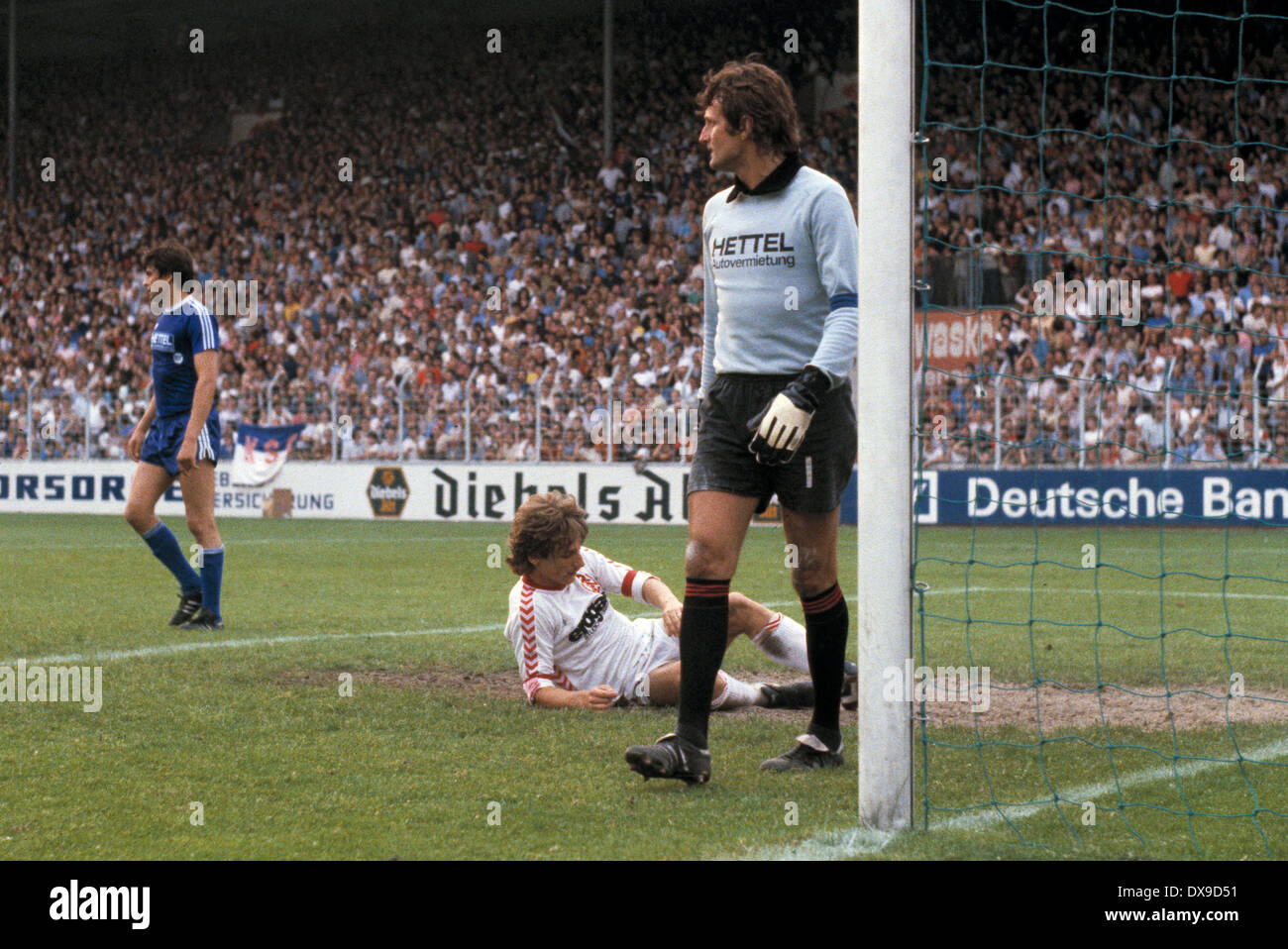 football, 2. Bundesliga Nord, 2. Bundesliga Sued, 1979/1980, relegation match to Bundesliga 1980/1981, return leg, Georg Melches Stadium, Rot Weiss Essen versus Karlsruher SC 3:1, scene of the match, f.l.t.r. Hermann Kohlenbrenner (KSC), Matthias Herget ( - Stock Image