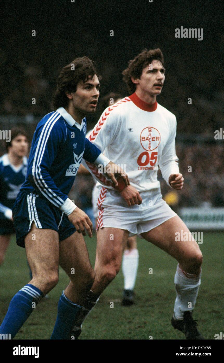 football, Bundesliga, 1980/1981, Grotenburg Stadium, FC Bayer 05 Uerdingen versus FC Schalke 04 1:3, scene of the match, Juergen Taeuber (S04) left and Norbert Hofmann (Bayer) - Stock Image