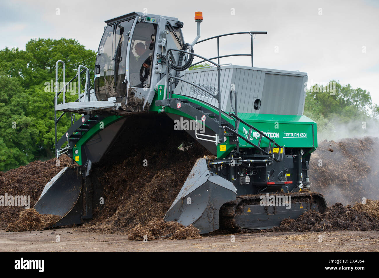 Komptech self propelled compost turner, turning over rotting bedding manure. Stock Photo