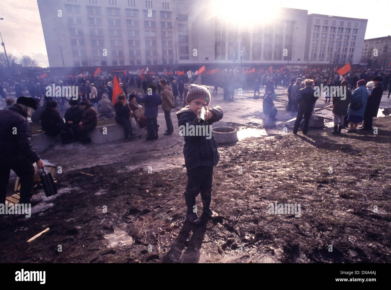 Boy pointing a toy gun after an anti-Yeltsin, pro-communist, demonstration at the Russian White House in 1993, Moscow. - Stock Image
