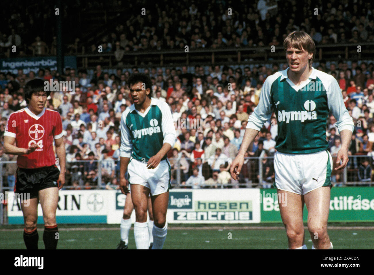 football, Bundesliga, 1983/1984, Ulrich Haberland Stadium, Bayer 04 Leverkusen versus SV Werder Bremen 0:0, scene of the match, f.l.t.r. Bum-Kun Cha (Bayer), Rigobert Gruber (Werder), Wolfgang Sidka (Werder) - Stock Image