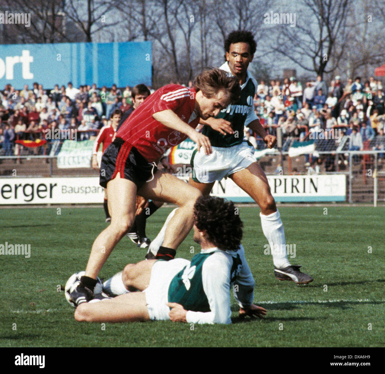 football, Bundesliga, 1983/1984, Ulrich Haberland Stadium, Bayer 04 Leverkusen versus SV Werder Bremen 0:0, scene of the match, tackling of Bruno Pezzey (Werder), left Helmut Winklhofer (Bayer), right Rigobert Gruber (Werder) - Stock Image