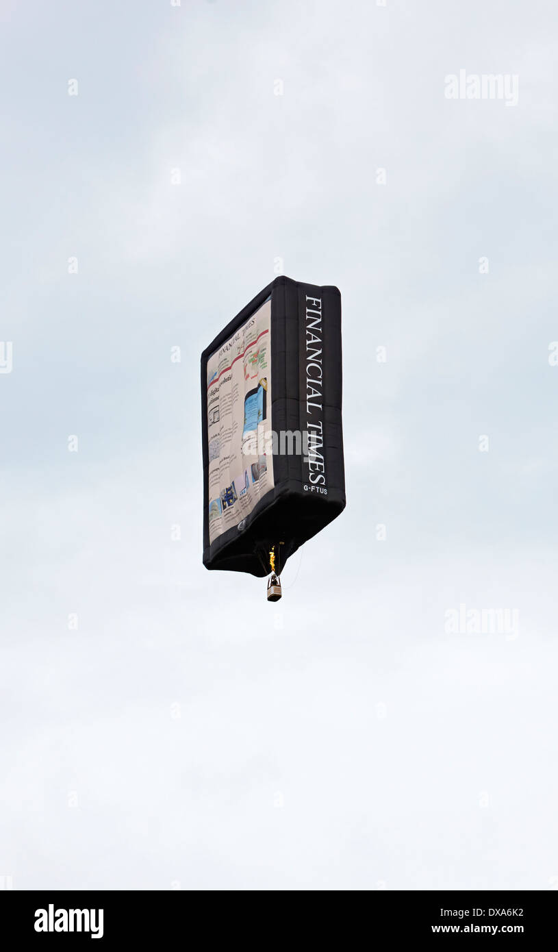 """Financial Times """"Tablet"""" Balloon at the 35th UK Bristol balloon fiesta at the Ashton court estate evening launch Stock Photo"""