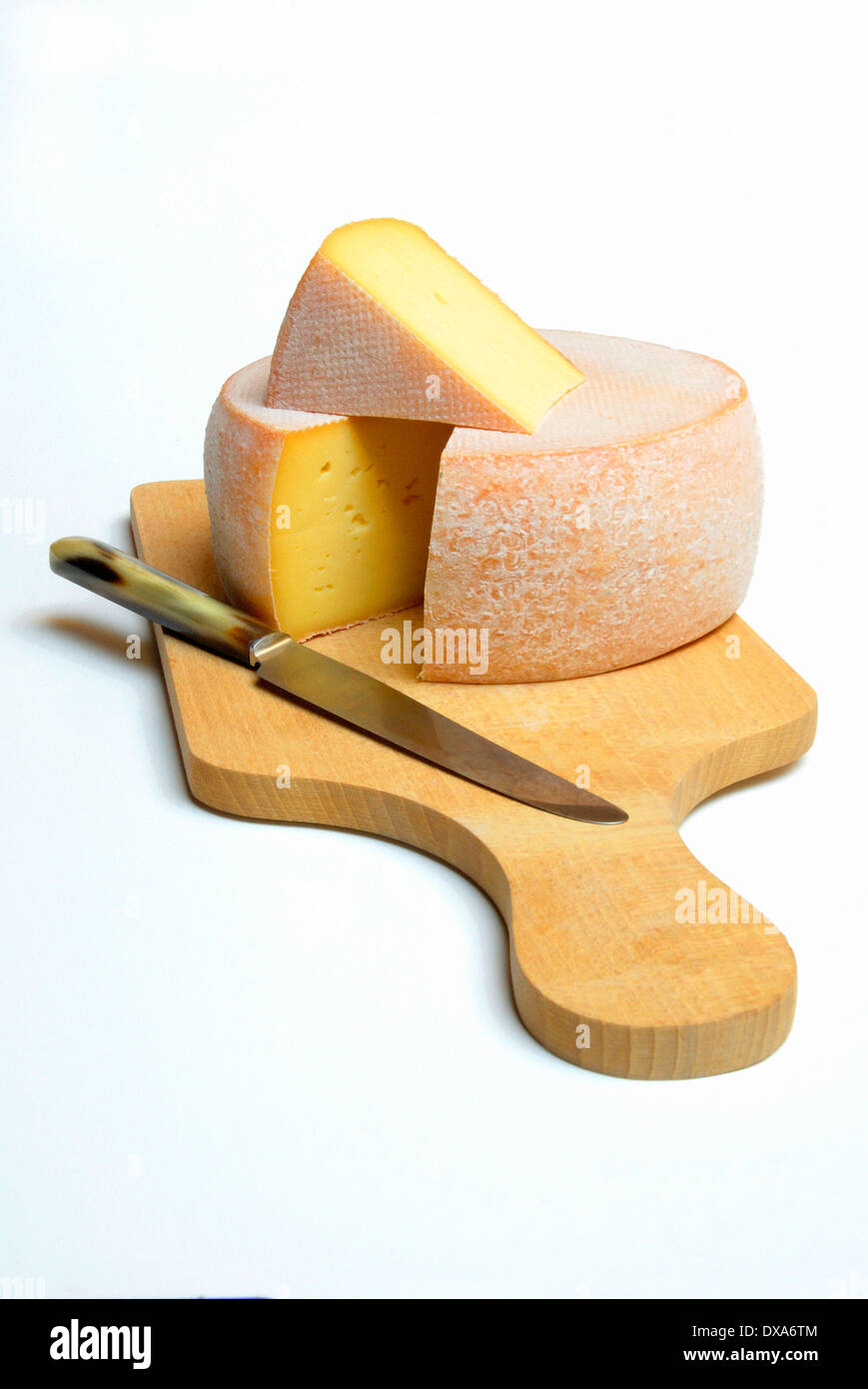 Cheese on cutting board - Stock Image