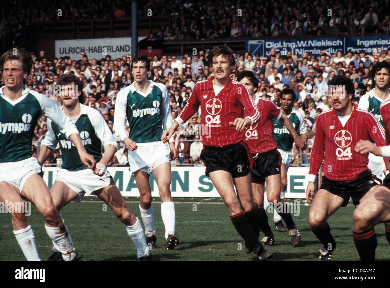 football, Bundesliga, 1983/1984, Ulrich Haberland Stadium, Bayer 04 Leverkusen versus SV Werder Bremen 0:0, scene of the match, f.l.t.r. Wolfgang Sidka (Werder), Rudi Voeller (Werder), Frank Neubarth (Werder), Juergen Gelsdorf (Bayer), Rudolf Wojtowicz (B - Stock Image