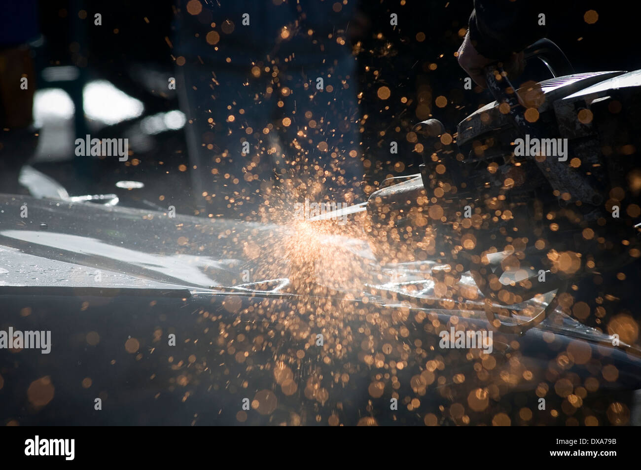 disk cutter cutting wheel angle grinder grinding cut steel metal sparks spark flying spray spraying of stihl saw Stock Photo