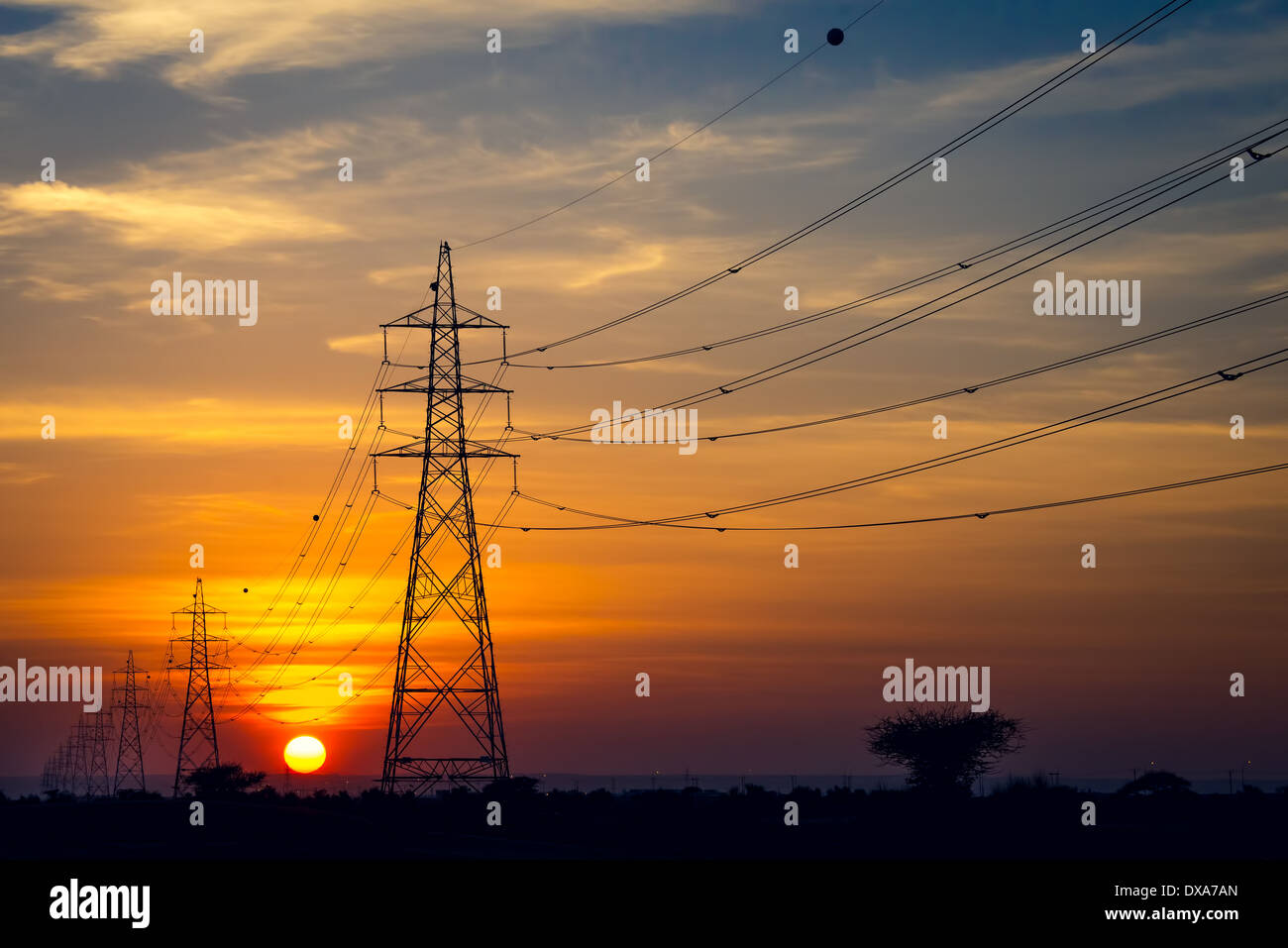 Transmission power line in sunset, concept for green eco energy - Stock Image
