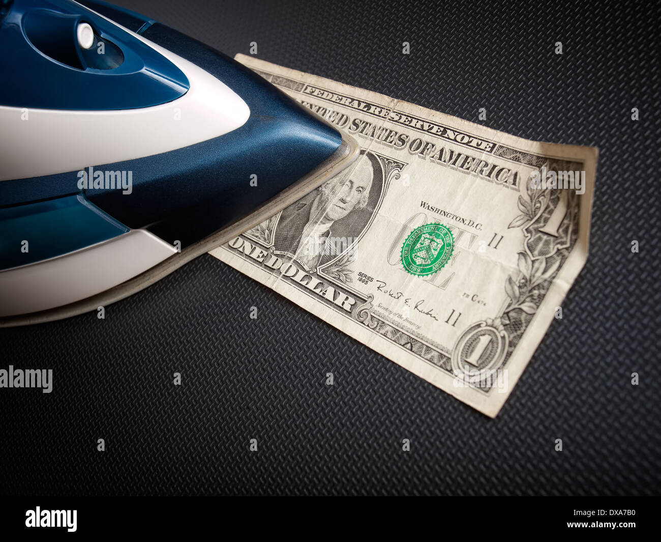 Ironing of money as a concept of what happens after the Money Laundering - Stock Image