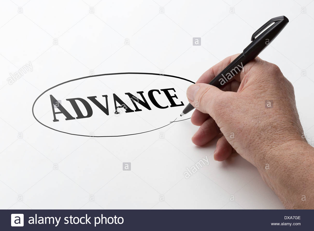 Man hand holding a black pen and encircling the word advance. - Stock Image
