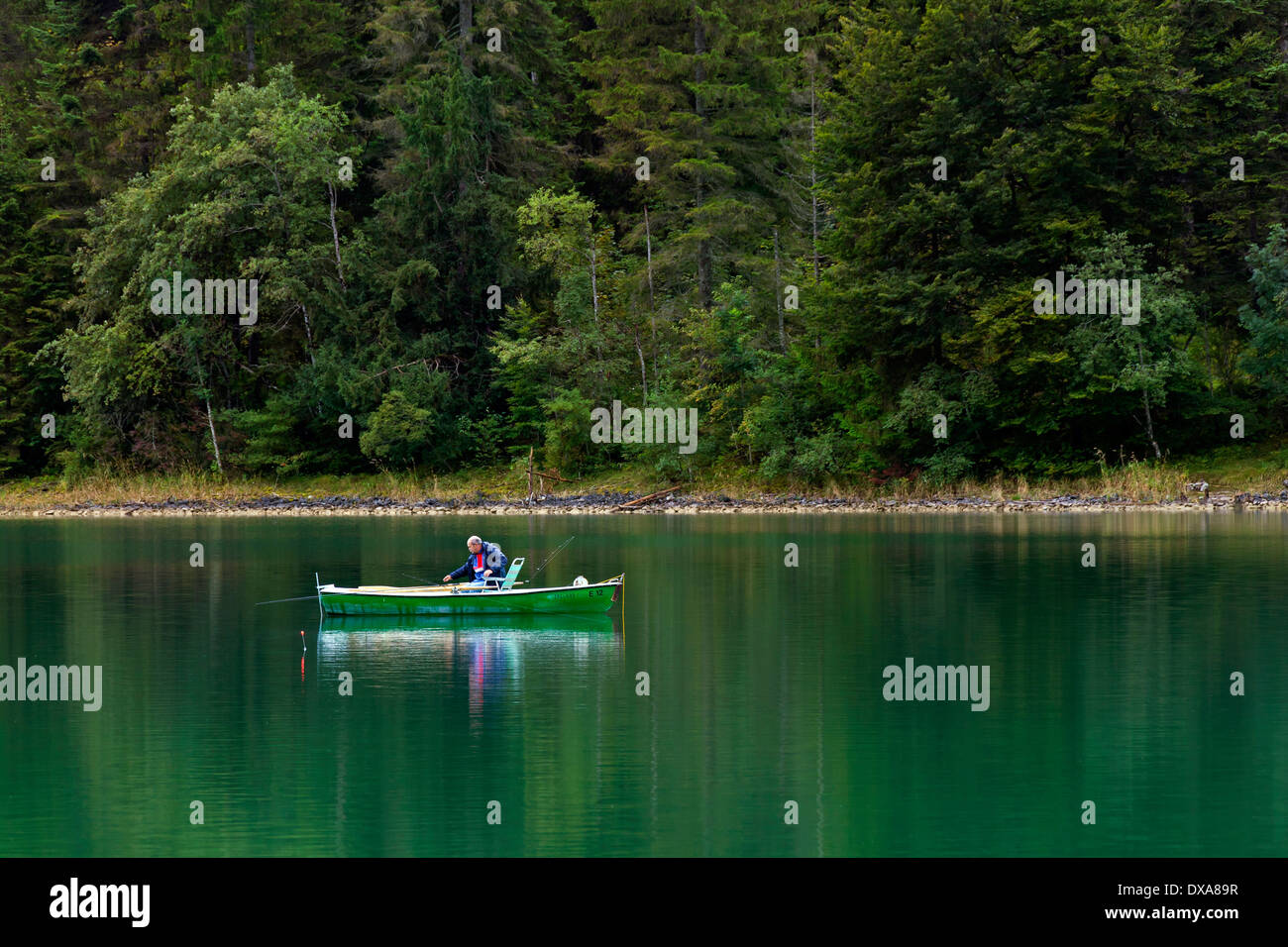 Angler fishing from rowing boat on the Walchensee / Lake Walchen, Upper Bavaria, Germany - Stock Image