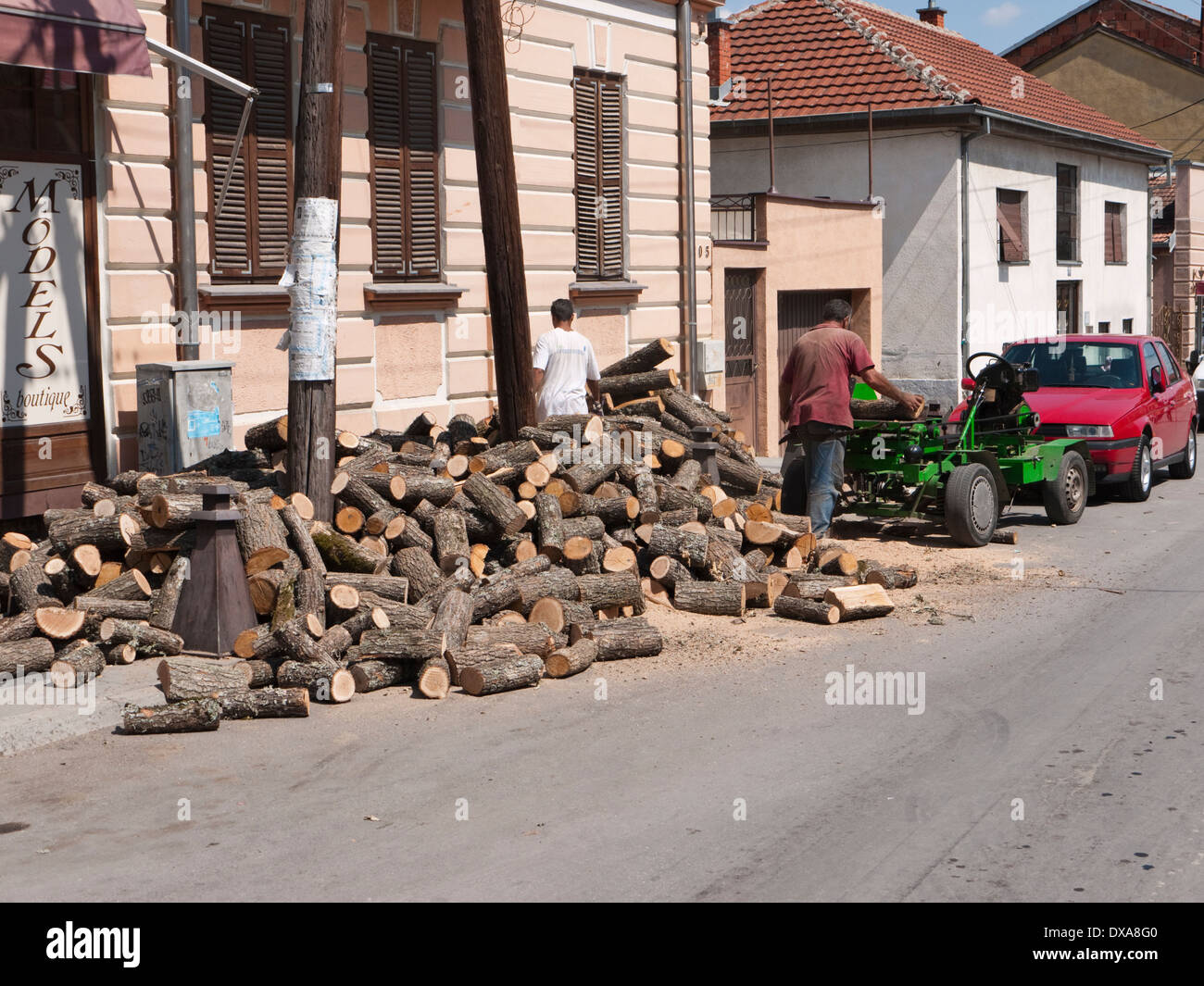 Wood cutters plying their trade in the back streets of Bitola, Republic of Macedonia - Stock Image