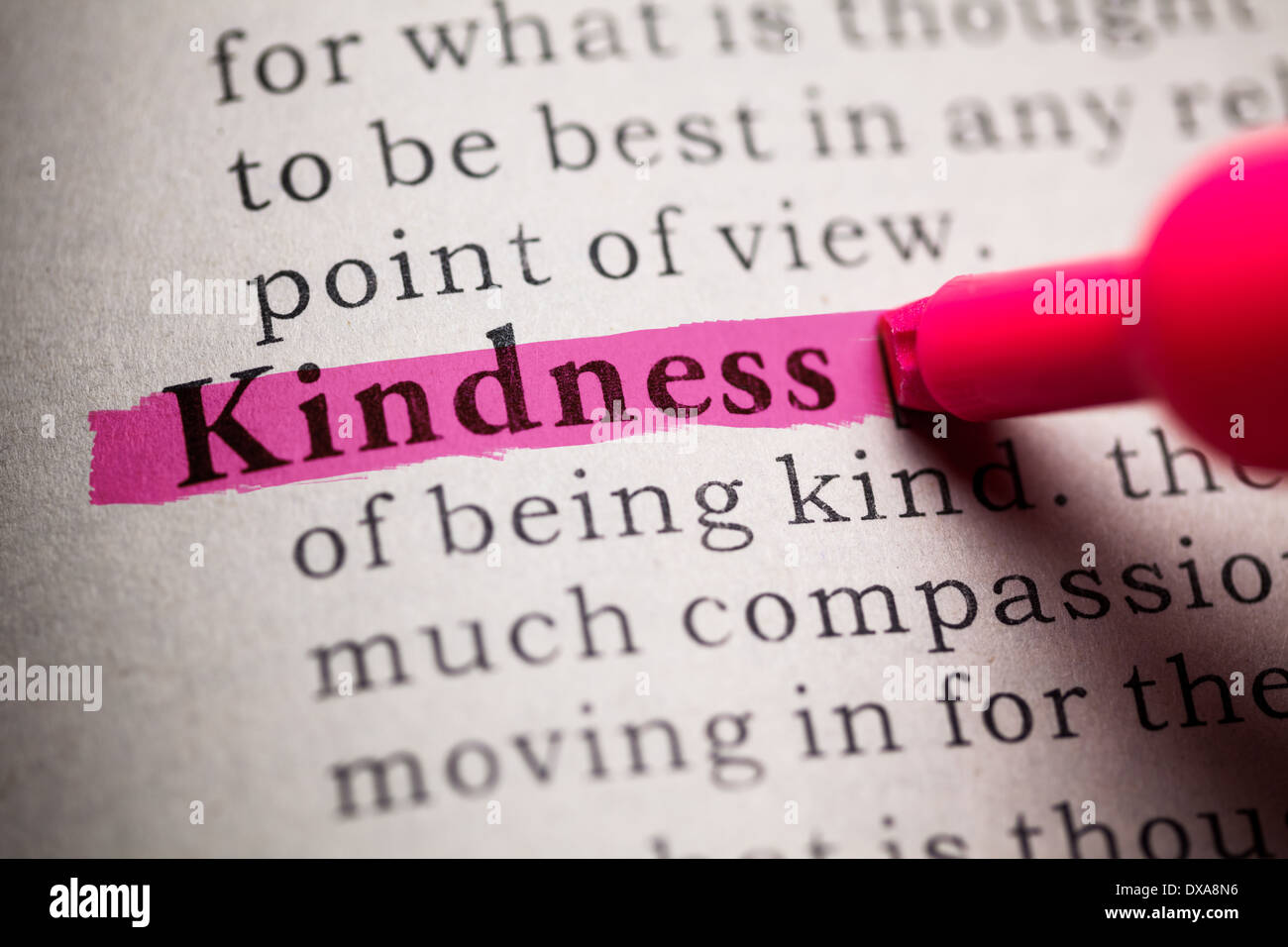 fake dictionary, definition of the word kindness stock photo