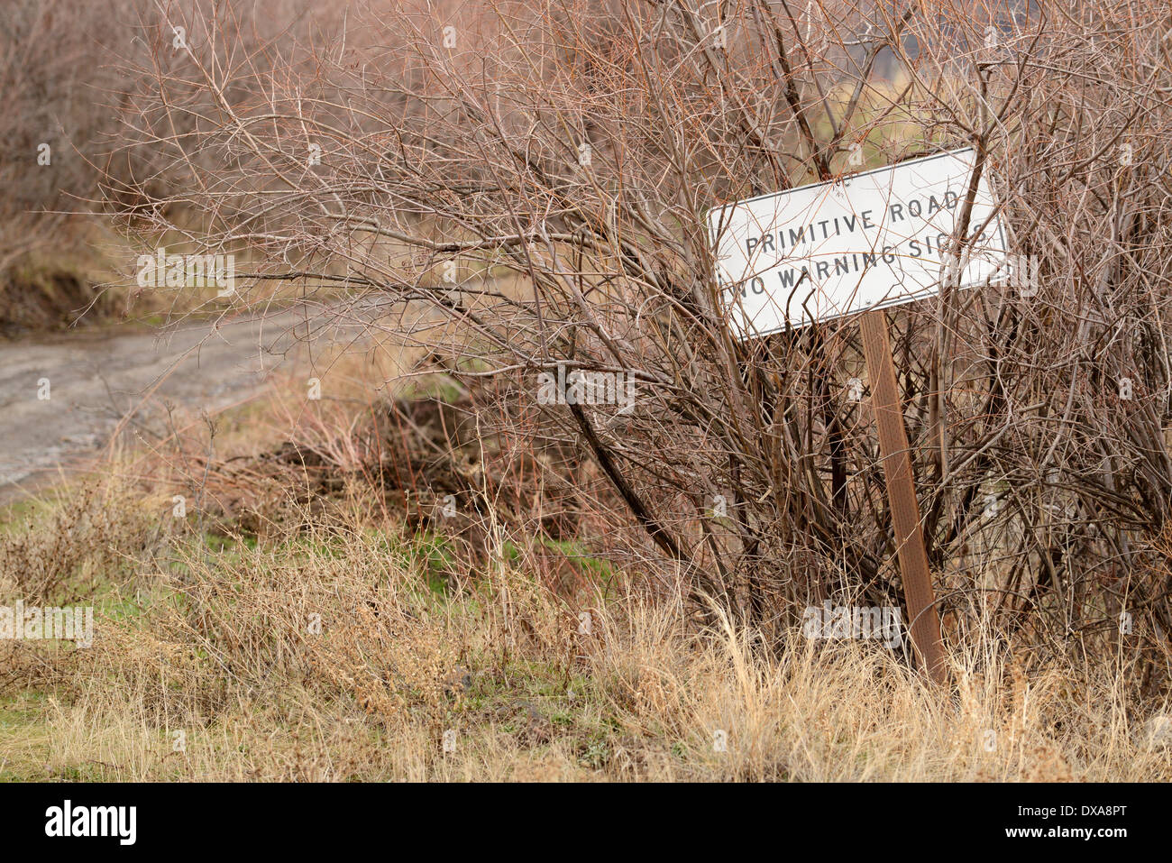 Primative road warning sign on the lower Imnaha River in Hells Canyon, Oregon. - Stock Image