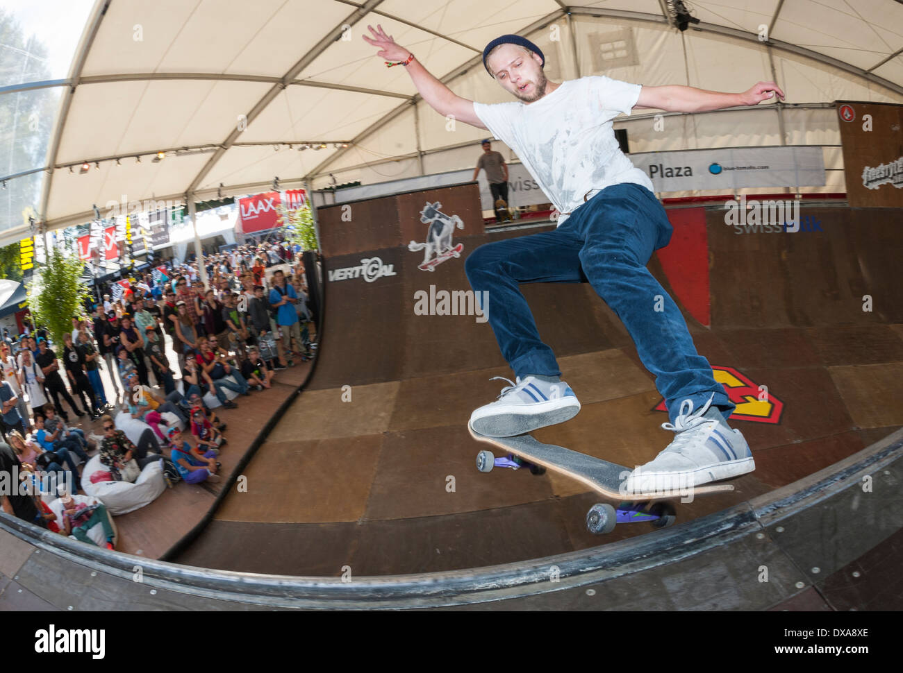 Skateboarder in the halfpipe at the 2013 freestyle.ch event in Zurich, Switzerland. - Stock Image