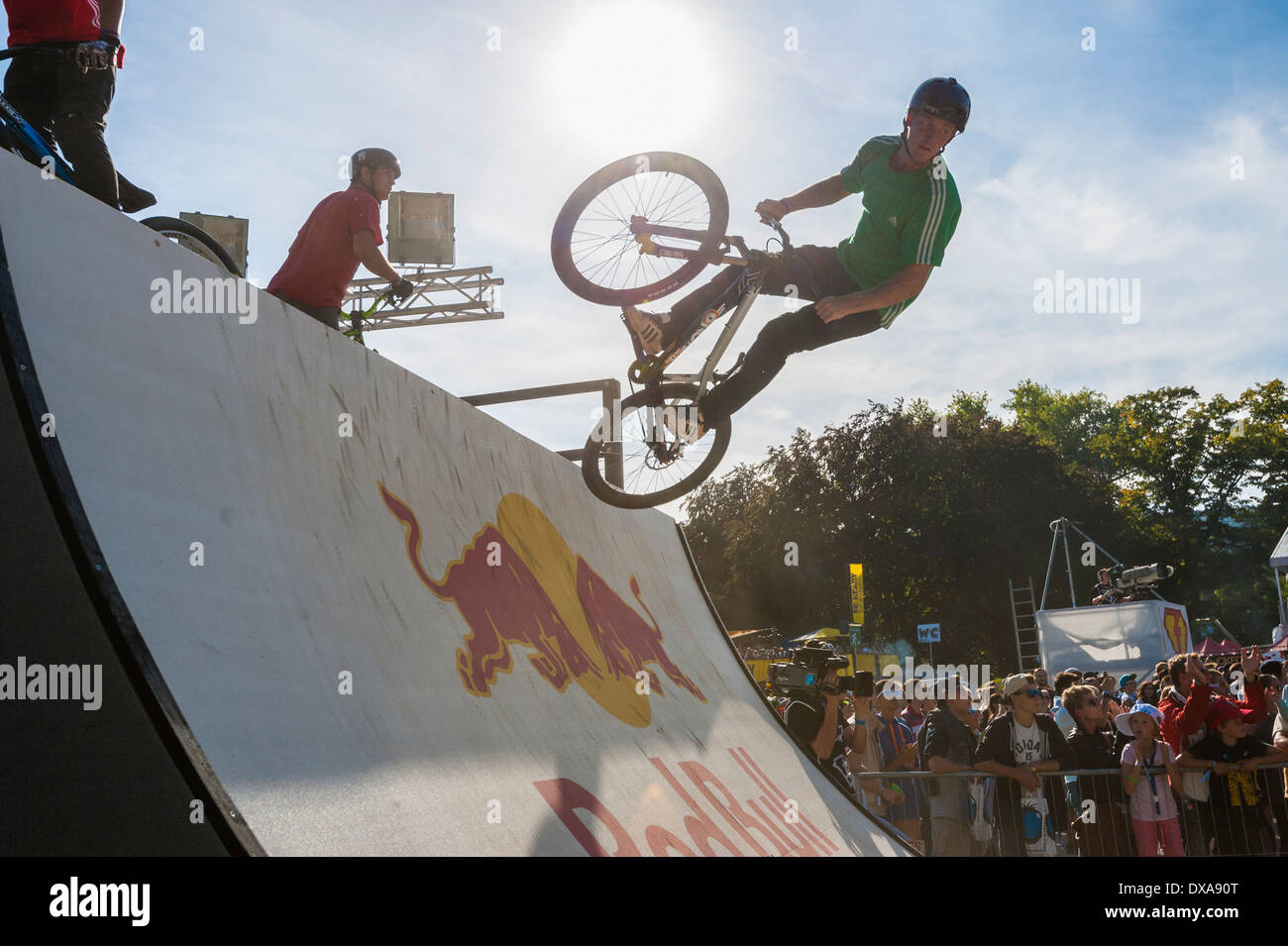Freestyle mountainbike (MTB) professionals show spectacular jumps and trick at the 2013 freestyle.ch competition in Zurich - Stock Image