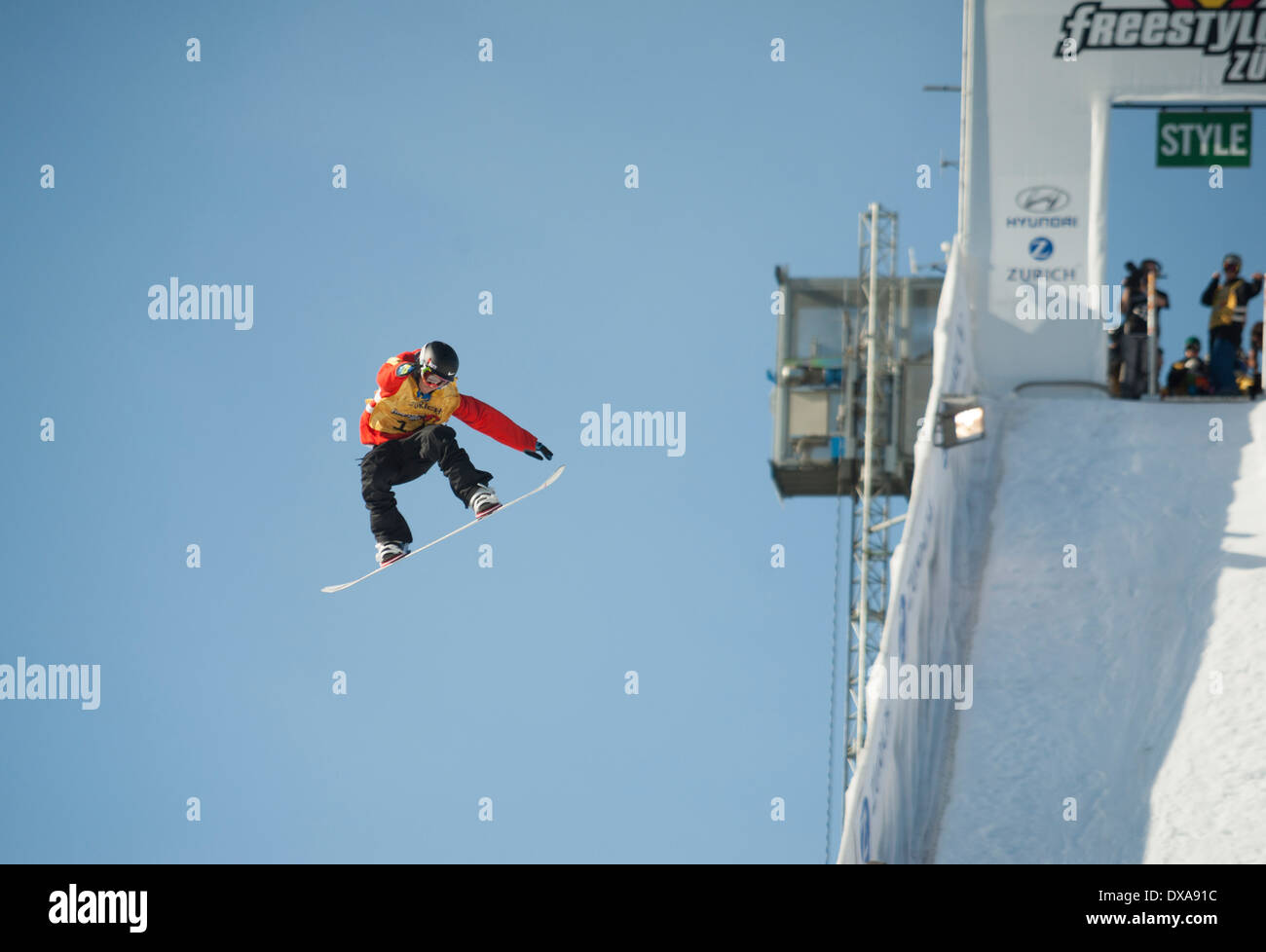 Freestyle snowboard professionals show spectacular jumps and flips at the 2013 freestyle.ch style session contest in Zurich. - Stock Image
