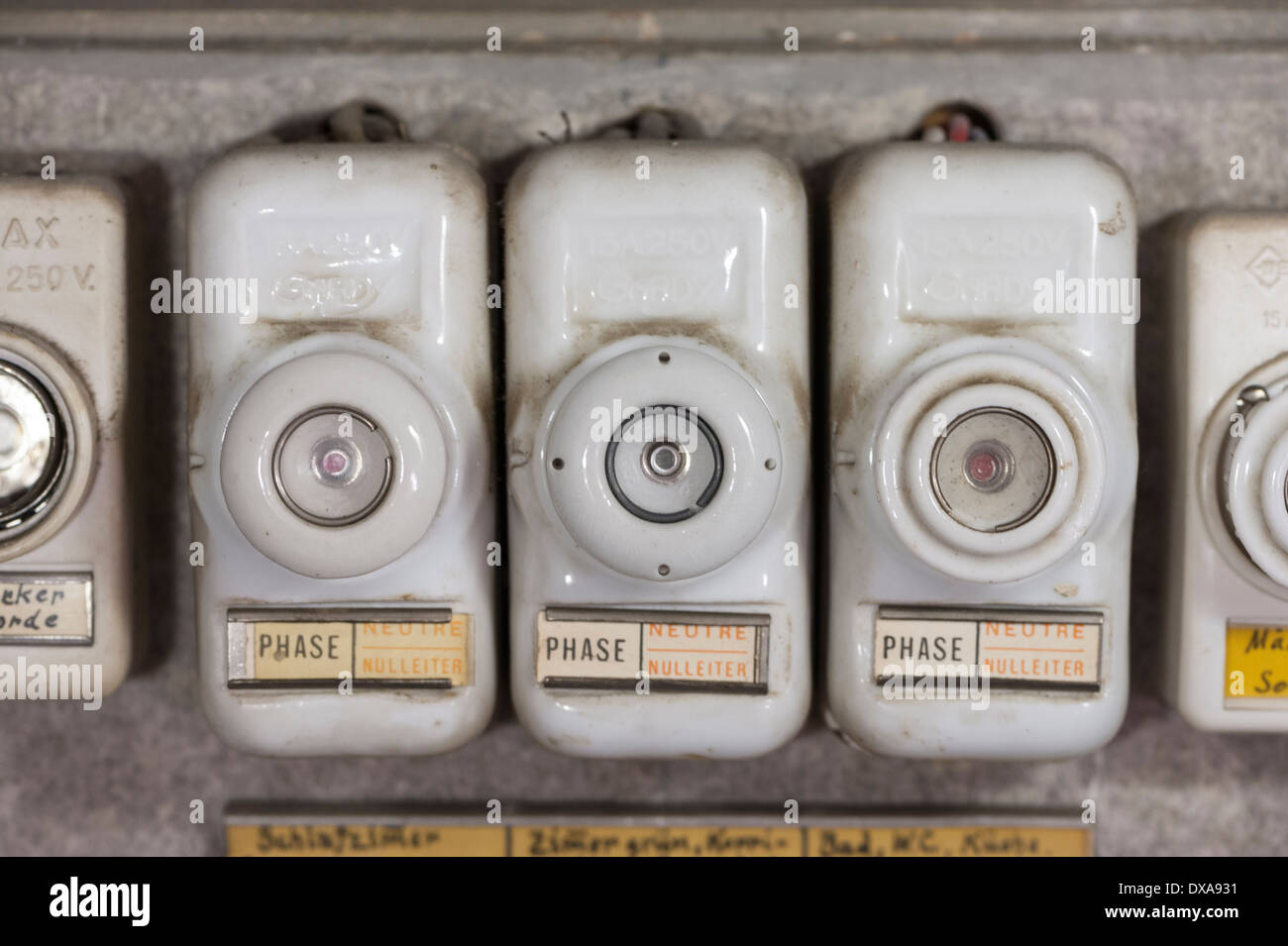 Close-up of an array of old-fashioned lead fuses in a household fuse