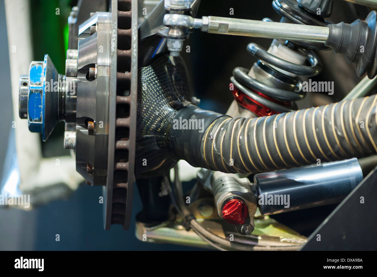 Close-up of a racing car front wheel suspension and brake disc - Stock Image