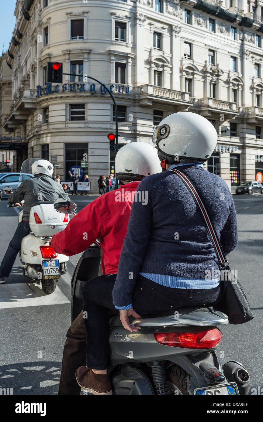Scooters are a popular and economical mode of transportation in Rome, Italy. - Stock Image