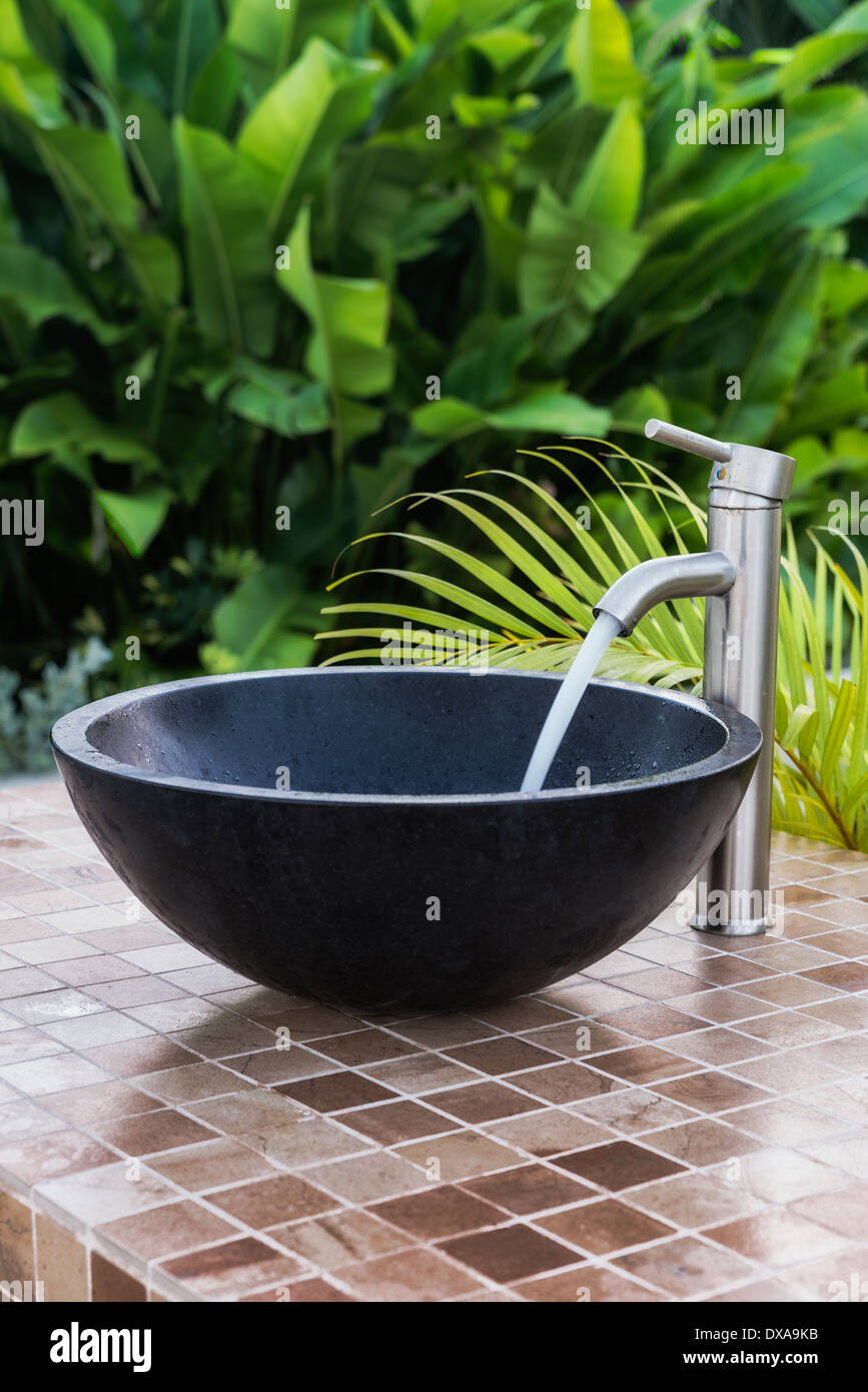 An outdoor bowl sink at a resort spa, Jamaica - Stock Image