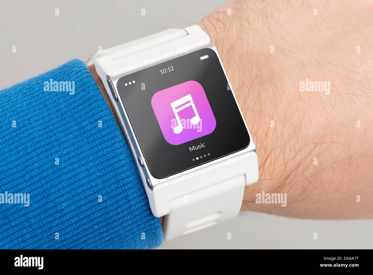Close up white smart watch with music app icon on the screen is on hand - Stock Image