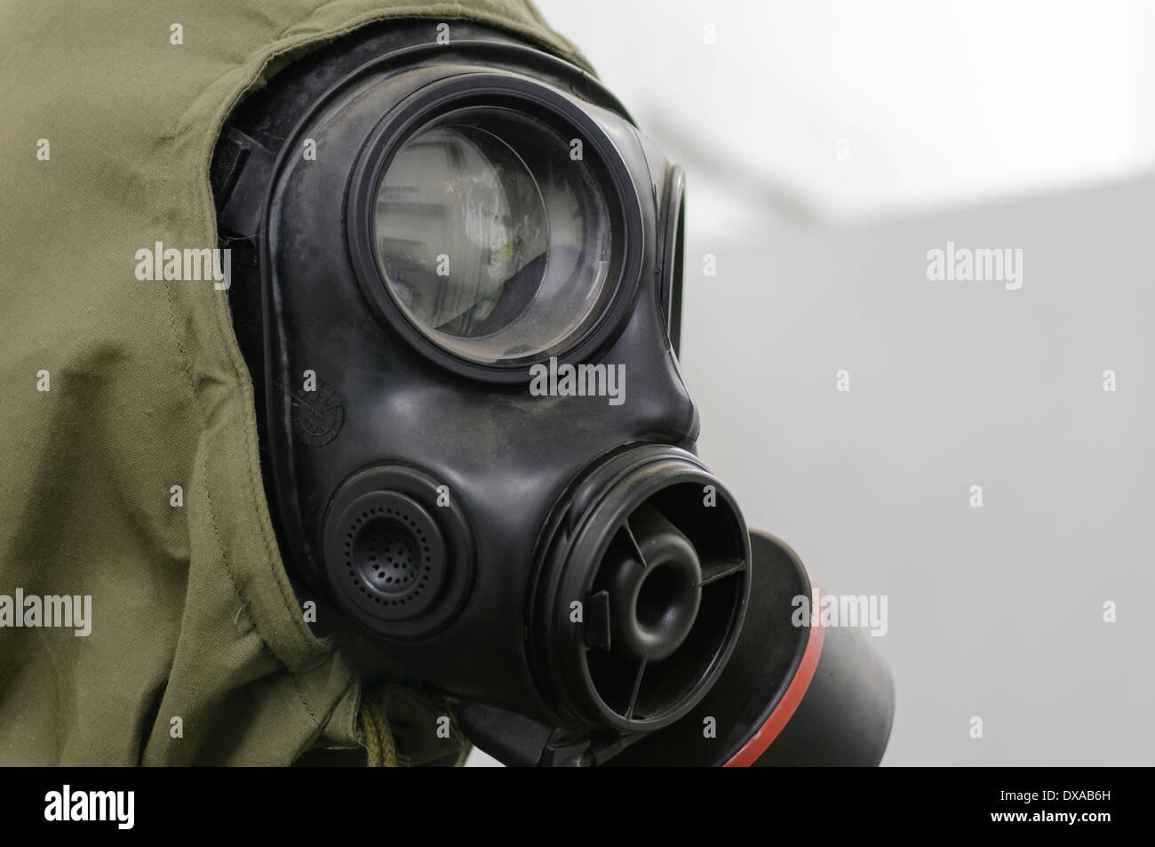 Gasmask and Nuclear, Biological and Chemical (NBC) suit - Stock Image