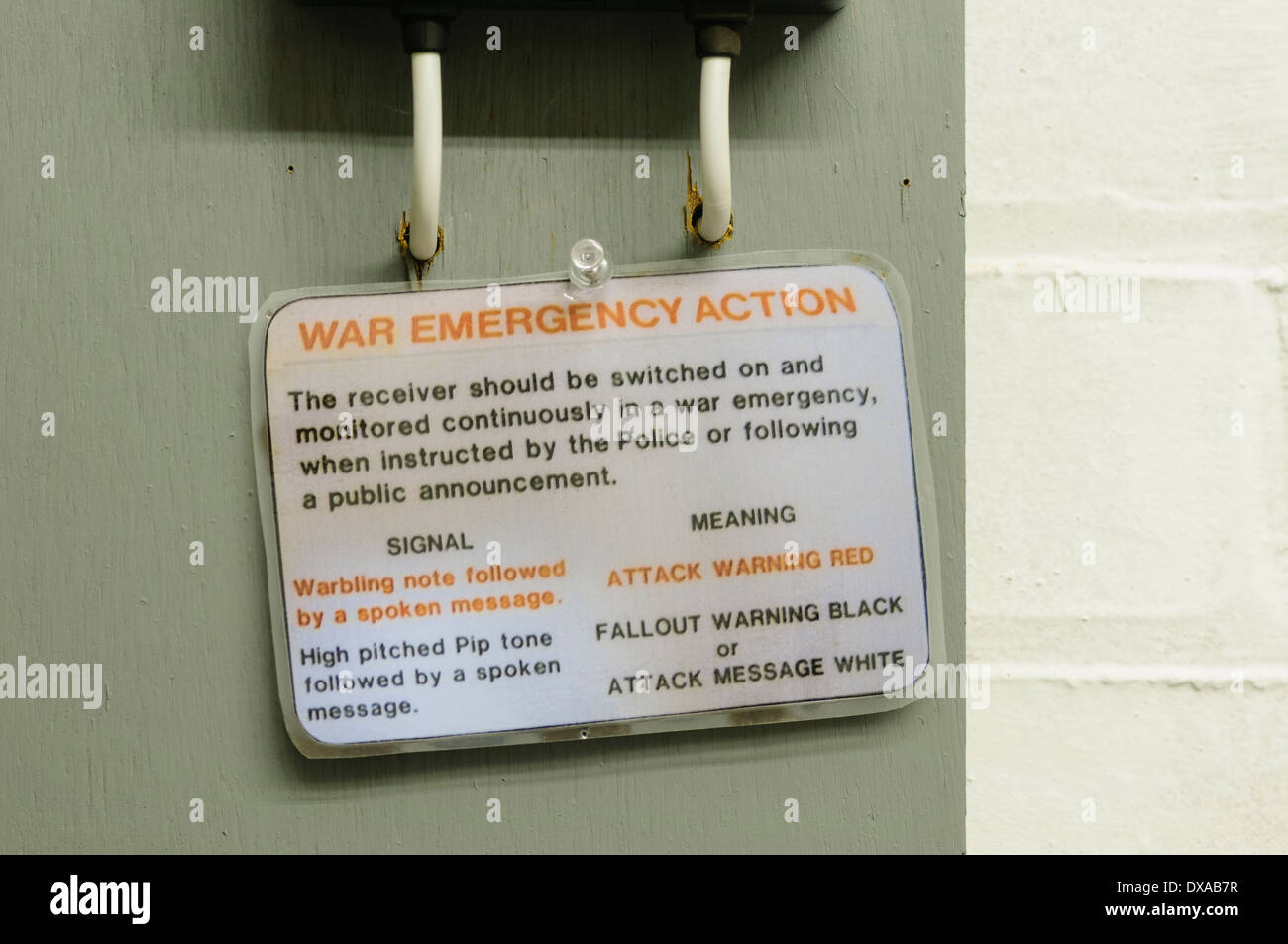 War Emergency Action notice card in a 1980s nuclear bunker - Stock Image