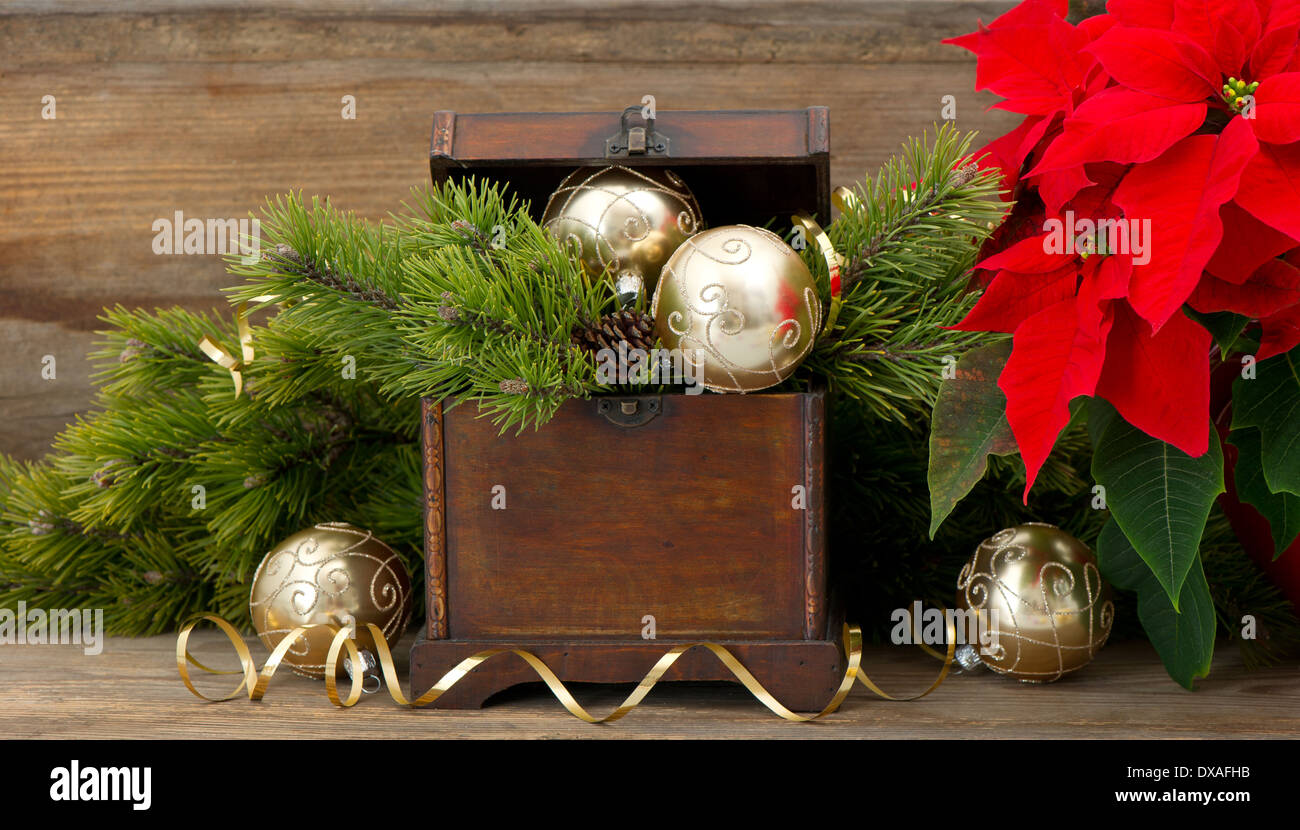 christmas tree brunch with golden decoration vintage wooden box and red christmas flower poinsettia - Wooden Box Christmas Decorations