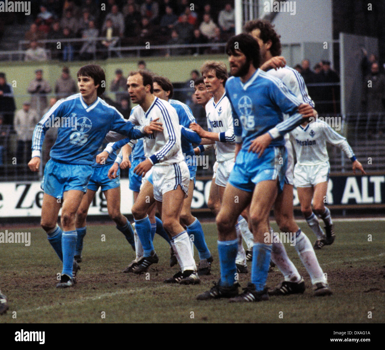 football, Bundesliga, 1984/1985, Grotenburg Stadium, FC Bayer 05 Uerdingen versus SV Waldhof Mannheim 2:2, scene of the match, f.l.t.r. Larus Gudmundsson (Bayer), Dimitrios Tsionanis (SVW), Horst Feilzer (Bayer) covered, Bernd Klotz (SVW) covered, Alfred - Stock Image