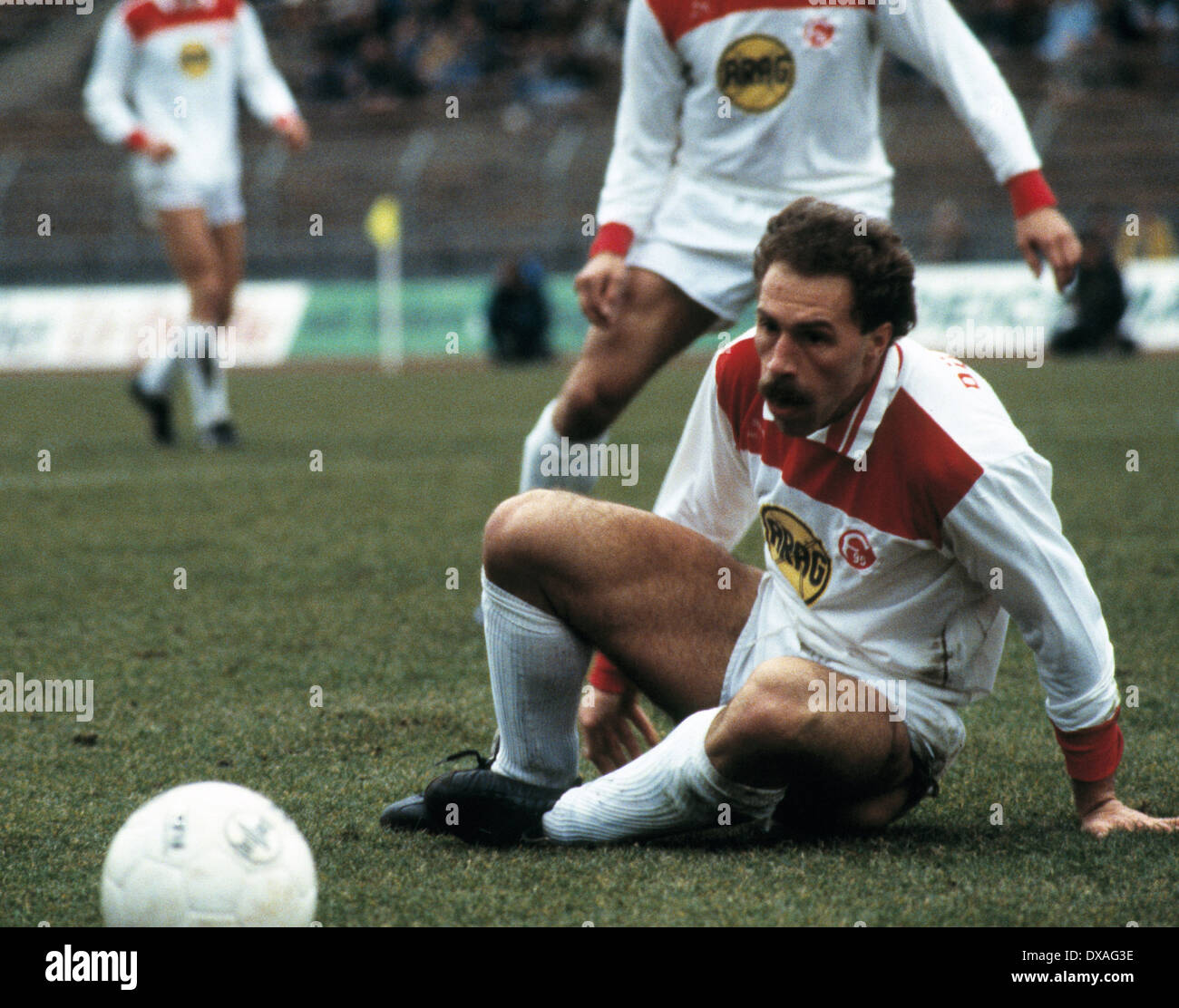 football, Bundesliga, 1984/1985, Rhine Stadium, Fortuna Duesseldorf versus FC Bayer 05 Uerdingen 2:2, scene of the match, Peter Loehr (Fortuna) sitting aground - Stock Image