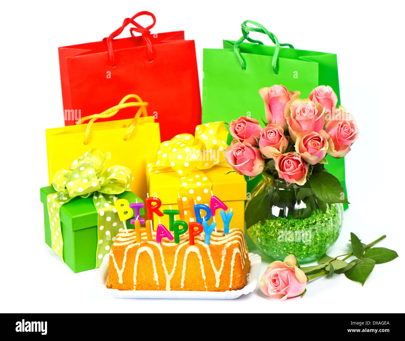 Happy birthday cake with candles flowers and gift stock photo happy birthday cake with candles flowers and gift izmirmasajfo