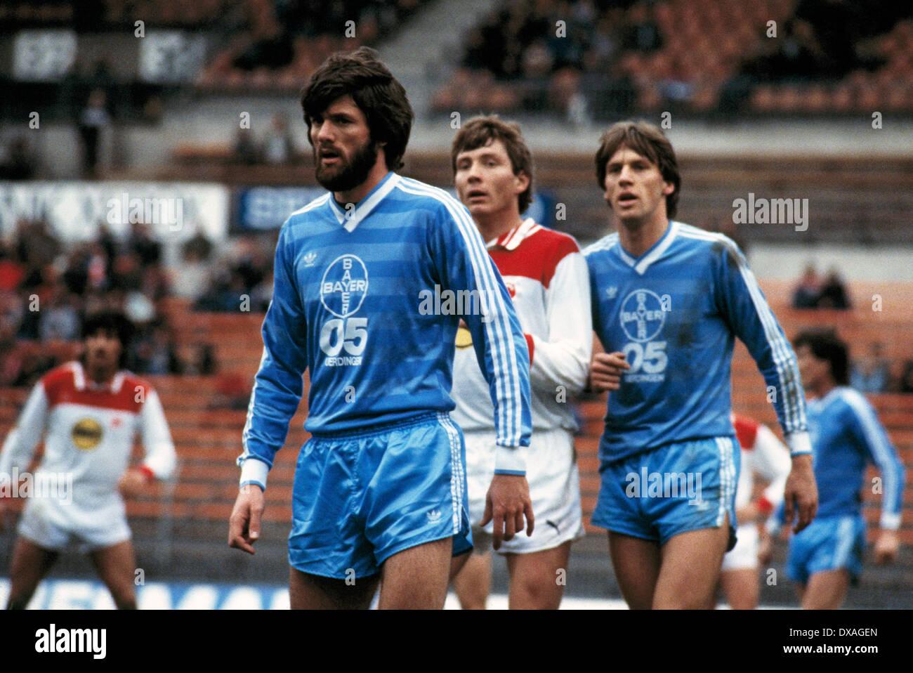 football, Bundesliga, 1984/1985, Rhine Stadium, Fortuna Duesseldorf versus FC Bayer 05 Uerdingen 2:2, scene of the match, f.l.t.r. Friedhelm Funkel (Bayer), Atli Edvaldsson (Fortuna), Wolfgang Funkel (Bayer) - Stock Image