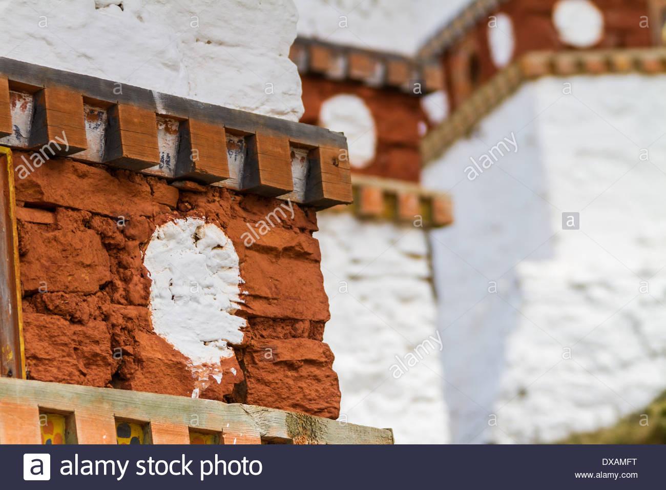 Designs on Buddhist stupas sit atop Dochu La Pass in Bhutan - Stock Image