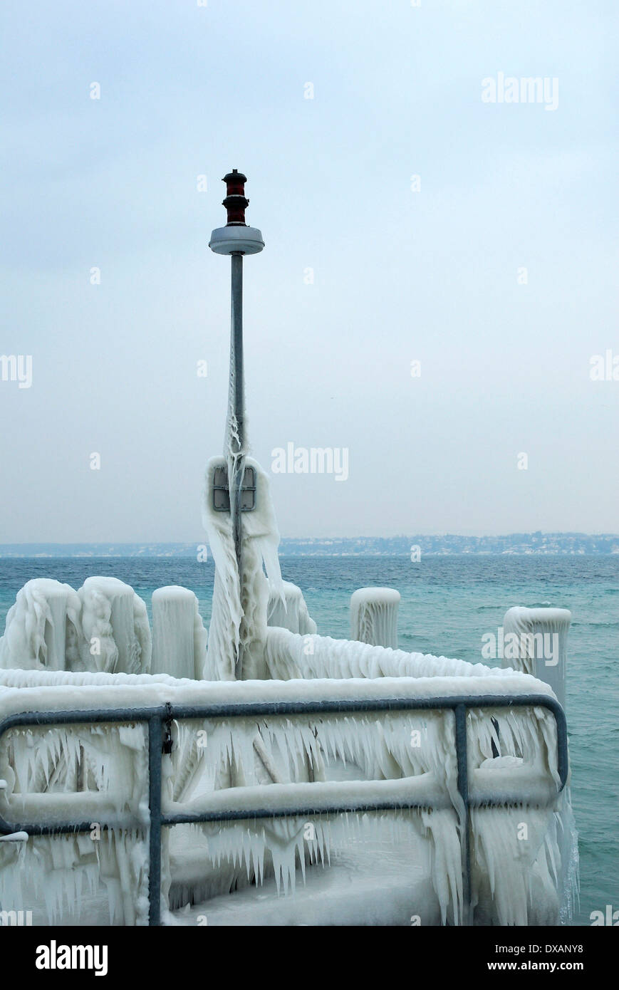 Handrail of landing stage covered with ice - Stock Image