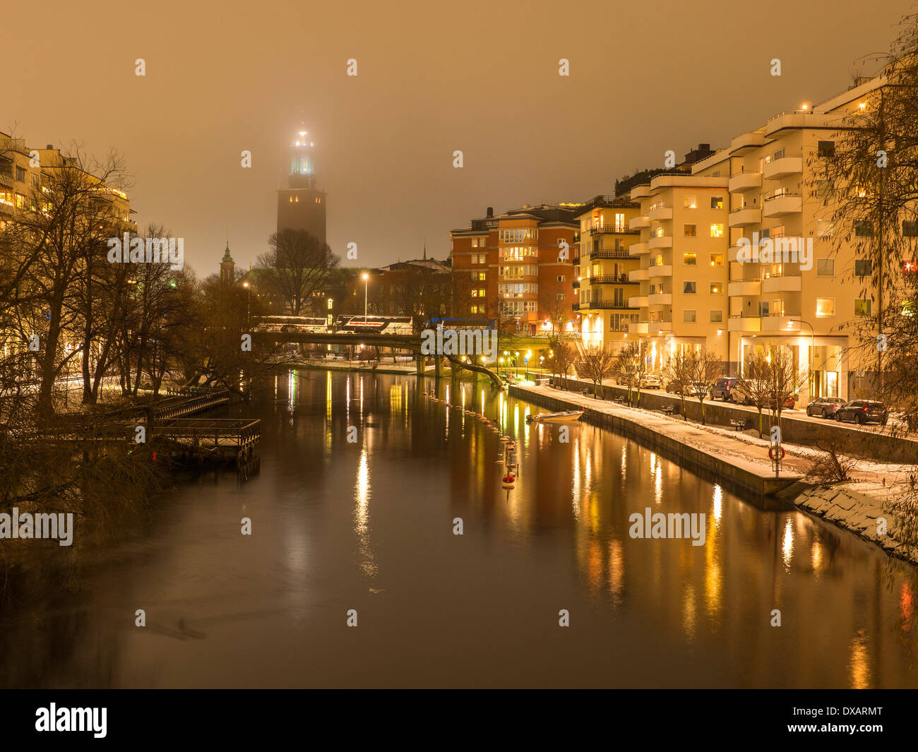 Evening view of Klara Sjö, ('Lake Klara'),  a waterway in Central Stockholm, separating Kungsholmen and Norrmalm.  Stockholm City Hall tower is seen. - Stock Image