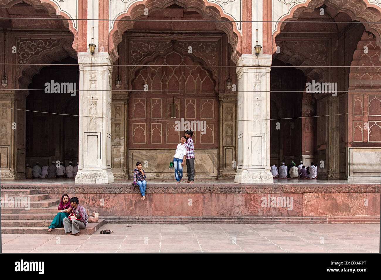 Worshippers inside and outside Jama Masjid Mosque in Delhi, India - Stock Image
