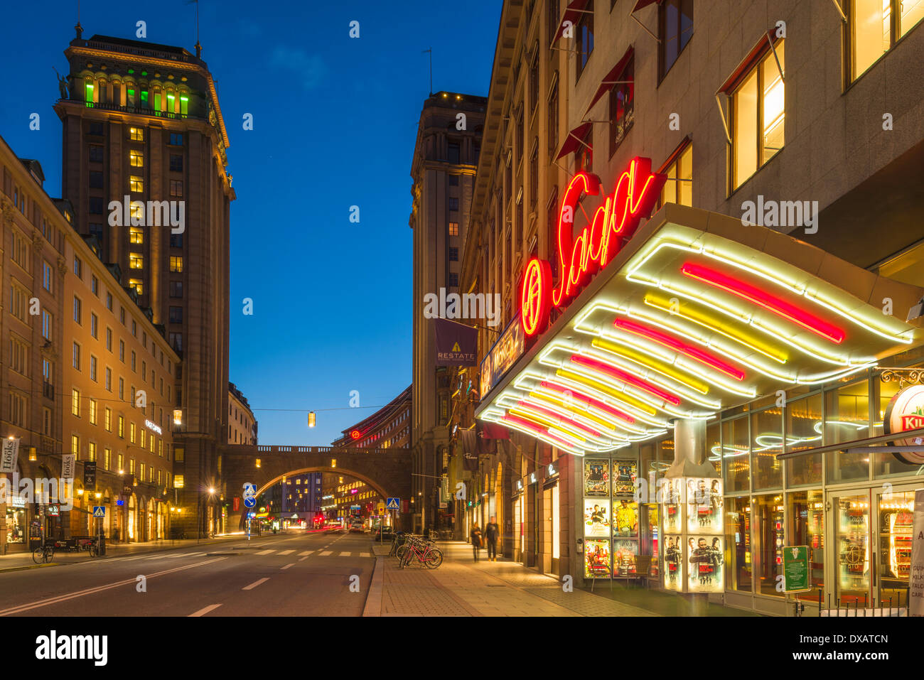 Evening view of Kungsgatan, a main street in central Stockholm.  To the right, is the Saga Cinema. - Stock Image