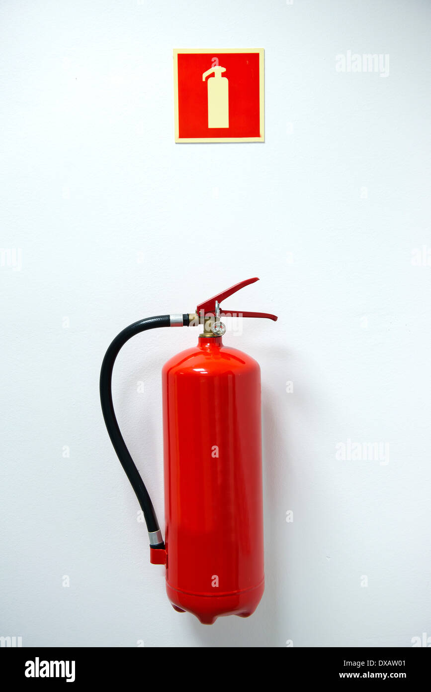 fire extinguisher and sign on the wall - Stock Image