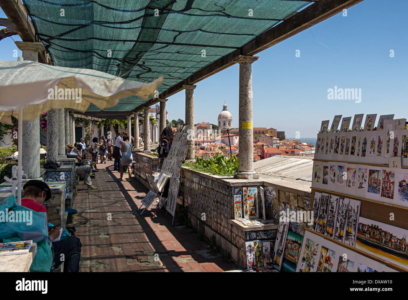 Tourists enjoying views of Alfama and Igreja de Santa Engrácia from Miradouro de Santa Luzia, in Alfama, Lisbon, Stock Photo