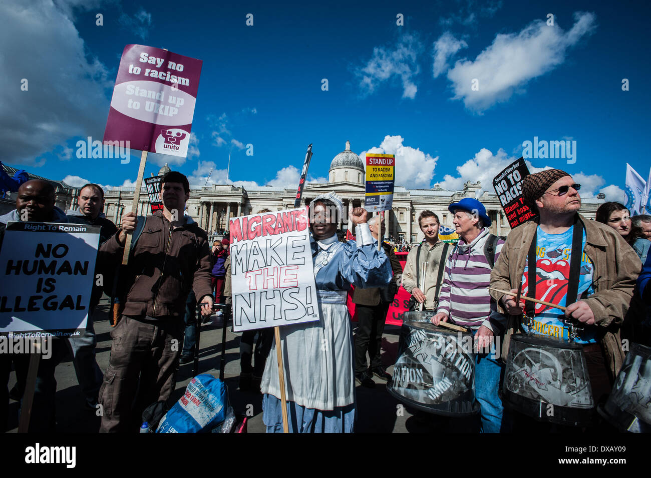 London, UK - 22 March 2014: a woman holds a placard reading 'Migrants make the NHS!' during the celebrations of the  United Nations International Anti-Racism Day. Credit:  Piero Cruciatti/Alamy Live News - Stock Image