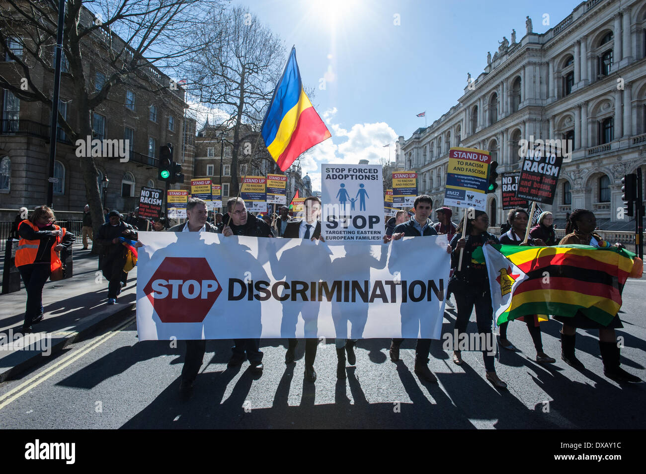 London, UK - 22 March 2014: marchers hold a banner reading 'Stop Discrimination'  to celebrate the United Nations International Anti-Racism Day. Credit:  Piero Cruciatti/Alamy Live News - Stock Image
