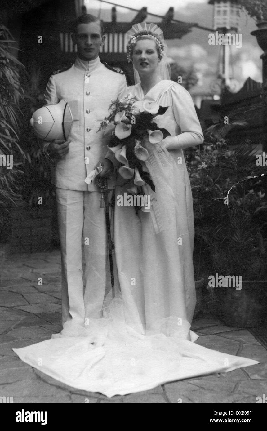 Royal Navy officer in white dress uniform on wedding day - Stock Image
