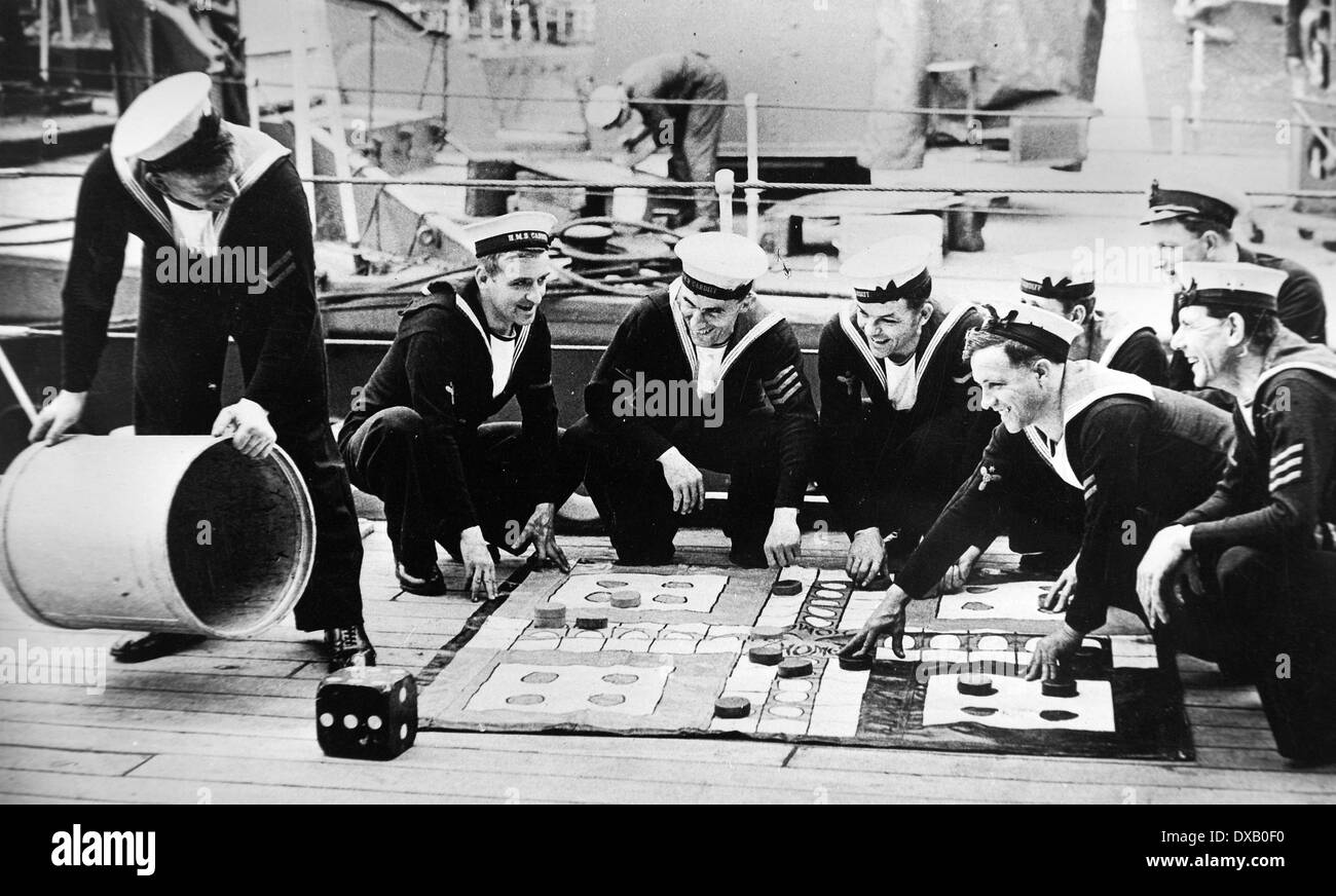Royal Navy seamen play uckers (Ludo) during a Sunday afternoon break ww2 - Stock Image