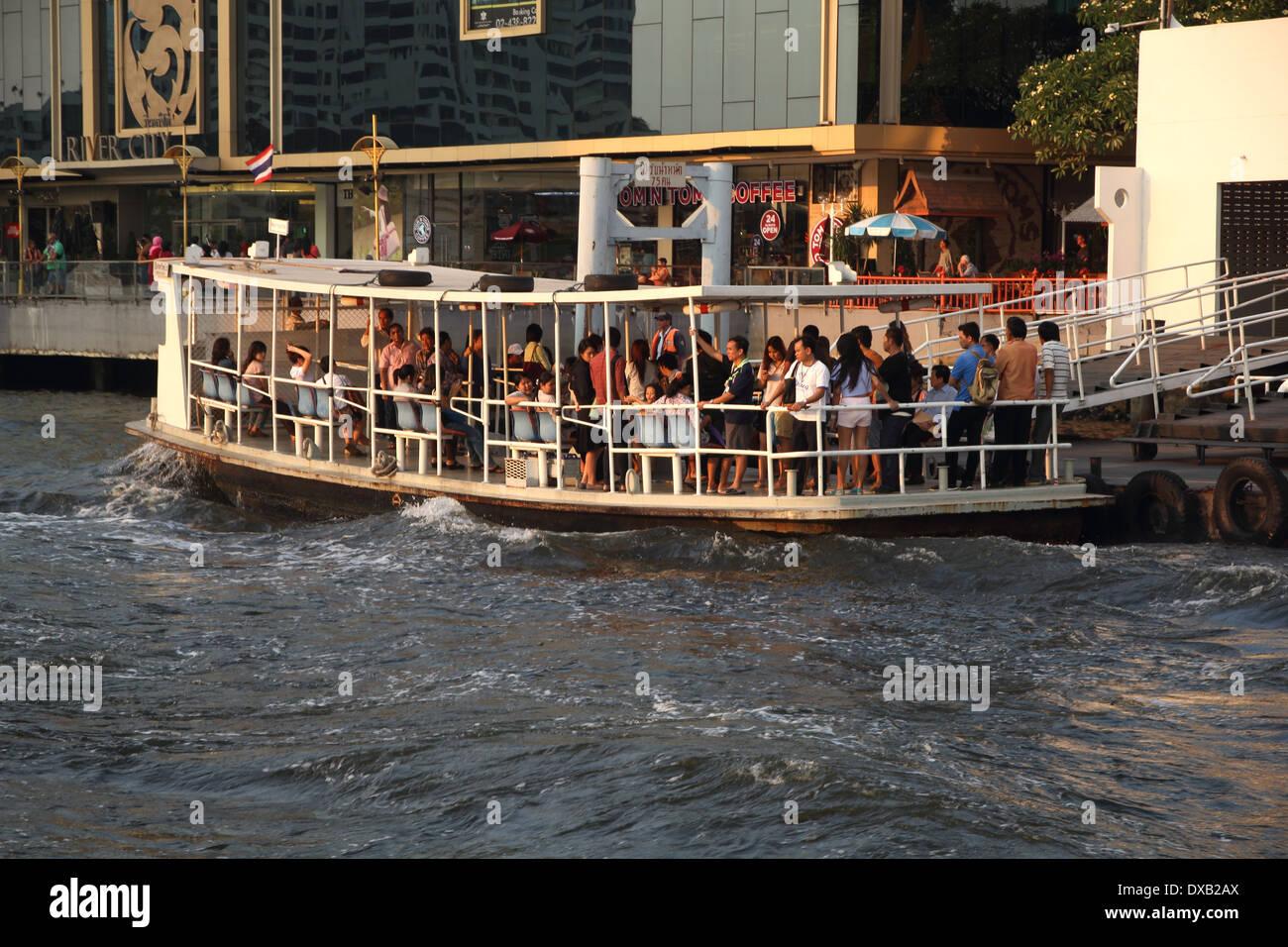 A ferry boat crossing Chao Phraya River in Bangkok , Thailand Stock Photo