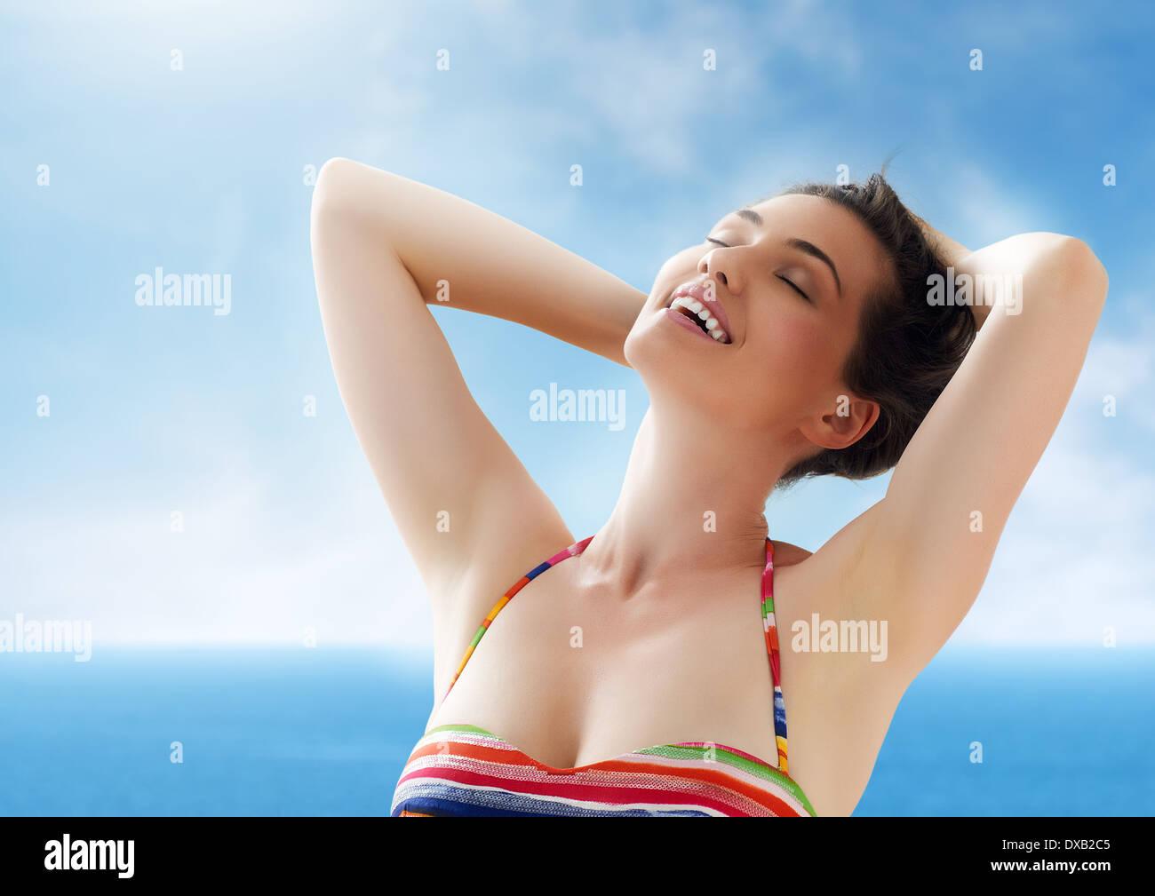 A beautiful girl enjoying summer sun - Stock Image