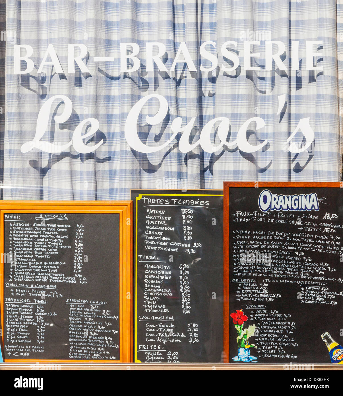 Bar brasserie menu and window in the old town of Colmar, Alsace, France. - Stock Image