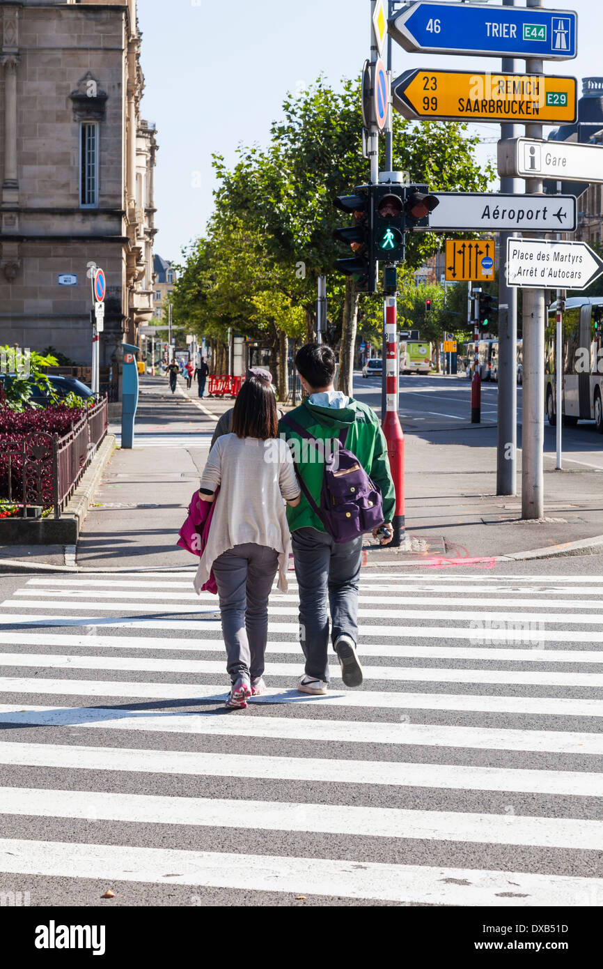 Tourists on pedestrian crossing in Luxembourg City, Luxembourg, Europe - Stock Image