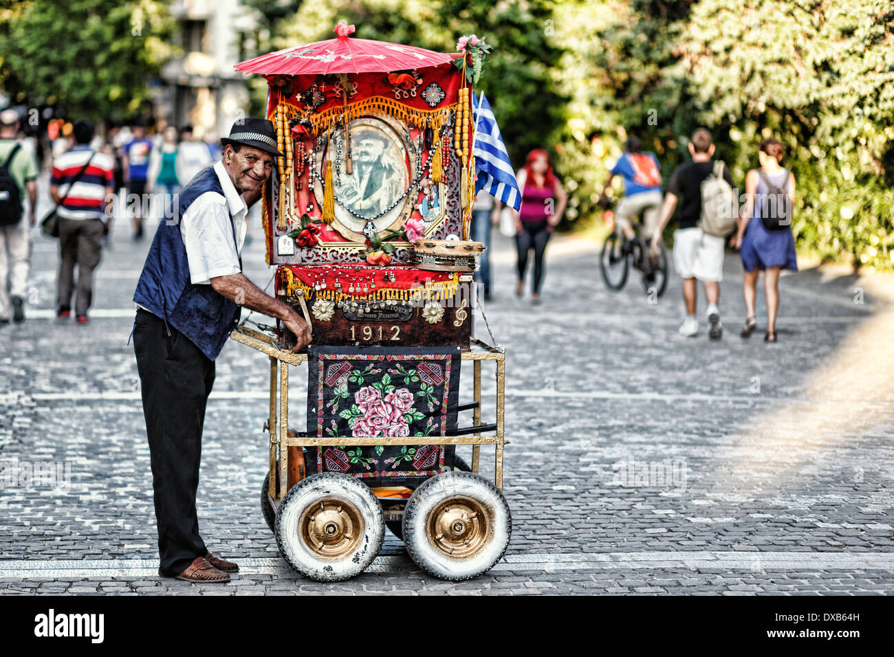 An old man playing lantern in the street of Athens, Greece - Stock Image